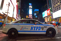 Samochodu policyjnego kwadrat przy nocą czasami Zdjęcie Royalty Free