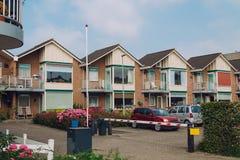 Samochody i domy Zdjęcia Stock