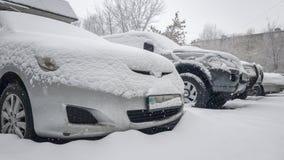 Samochody snowing zdjęcie stock