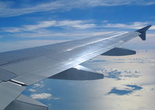 Samolot chmury i skrzydło Zdjęcia Stock