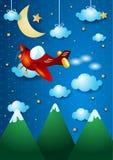 Samolot nad górą Obrazy Royalty Free