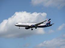 Samolot a321 w chmurnym niebie Obraz Royalty Free