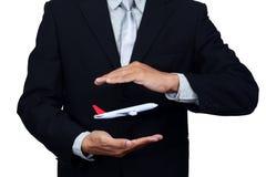 Samolotowy lot w ręce biznesmen, na bielu zdjęcia stock