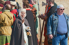 Group of people in medieval clothes Royalty Free Stock Photos