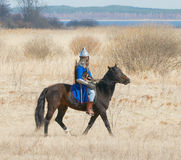 Knight in an armor astride a horse Stock Images