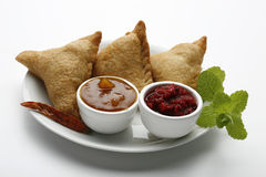 Samosa. S on a white plate with sauce Royalty Free Stock Photography