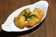 Samosa. Crispy and potato filled homemade Samosa snacks in a plate with copy space, selective focus Royalty Free Stock Photography