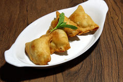 Samosa. Crispy and potato filled homemade Samosa snacks in a plate with copy space, selective focus Stock Photos