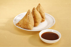 Samosa - Deep Fried patty Filled with potato & vegetables Stock Photo