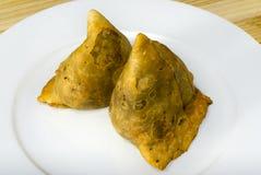 Samosa. Fried samoosa on a white plate Royalty Free Stock Photo