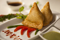 Samosa- An Indian fried, baked pastry. Stock Photos