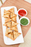 Samosa / Samoosa with mint & tomato chutney Stock Image