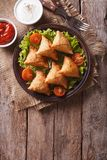 Samosa on a plate with sauce on a plate , vertical top view Stock Photo
