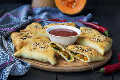 Samosa with pumpkin - traditional oriental pastries Royalty Free Stock Image