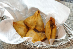 A samosa, or samoosa, is a fried or baked dish Stock Photos