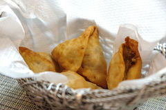 A samosa, or samoosa, is a fried or baked dish Royalty Free Stock Image