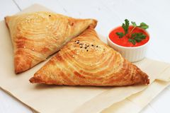 Samosa and sauce on white wooden background, Indian food stock photo