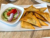 Samosa with thai cucumbe relish.  stock image