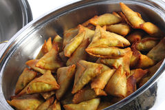 Samosas in a bowl stock images