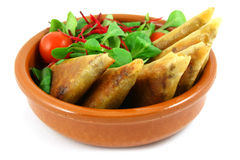 Samosas in a bowl. Samosas and salad bowl, isolated on white Stock Image