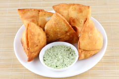 Samosas with fresh coconut mint sauce. Royalty Free Stock Photos