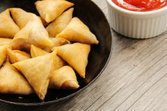 Samosas Indian snack in frying pan Royalty Free Stock Photos