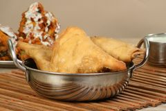 Samosas in a metal dish Royalty Free Stock Image