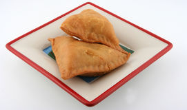 Samosas in plate. Hot and spicy samosas in plate Royalty Free Stock Photo