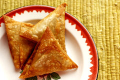 Samosas. On a red and white plate Royalty Free Stock Photos