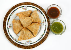 Samosas with sauce Stock Images