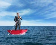 Samotny biznesmen w morzu Fotografia Stock