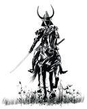 Samourai with sword on a horse stock photos