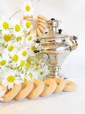 Samovar. With bagels and chamomile Royalty Free Stock Photo