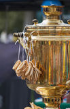 Samovar with bagels. The Russian samovar with the bagels hanging on it Royalty Free Stock Photos