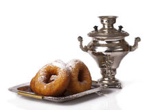 Samovar and donuts Stock Photography