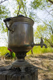Samovar in the forest. Samovar in the Russian forest sunset Stock Photo