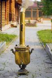 Samovar with heating costs on the street. Country house Royalty Free Stock Images