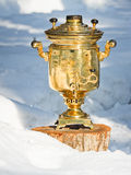 Samovar in the snow Stock Images