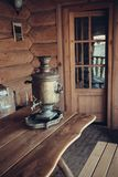 The samovar is on the table. Interior of a peasant izba. Closeup. Retro. Selective focus stock photography