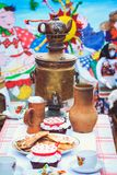 Samovar on the table next to rustic dishes stock images