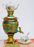 Samovar, tea drinking ceremony. Samovar Cup with a spoon and tea linum tablecloths Royalty Free Stock Photography