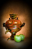 Samovar and two apples Stock Photography