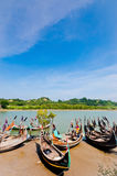 Sampan boats and the green mountain. Resting Sampan boats and the green mountain Royalty Free Stock Photography