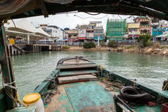 Sampan ferry arriving pier on Cheung Chau Island Royalty Free Stock Photo