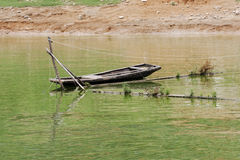 A traditional chinese sampan tied up to a fishing trap on the Yangtze River. Stock Photography