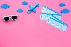 Sample of airplane ticket. Family trip with kid. Airplan toy and sun glasses. Pink background flat lay space for text.  Royalty Free Stock Photography