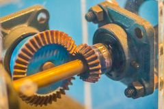 Sample of bevel gear set. Bevel gears are gears where the axes o. F the two shafts intersect and the tooth-bearing faces of the gears themselves are conically stock photography
