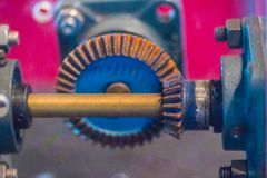 Sample of bevel gear set. Bevel gears are gears where the axes o. F the two shafts intersect and the tooth-bearing faces of the gears themselves are conically royalty free stock photos