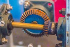 Sample of bevel gear set. Bevel gears are gears where the axes o. F the two shafts intersect and the tooth-bearing faces of the gears themselves are conically royalty free stock photography