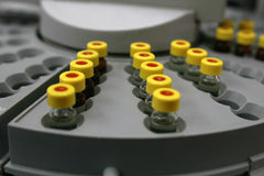 Sample Bottles. A set of Sample bottles in a testing machine Stock Photos